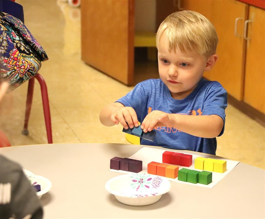 A Maroun student assembles blocks during the recent open house.