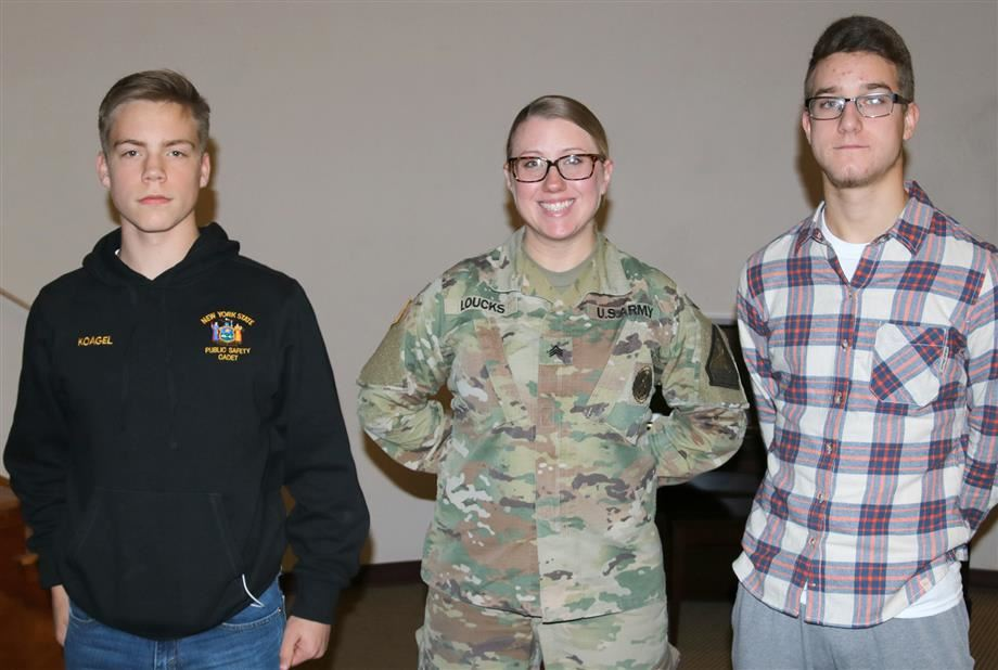 Sgt. Erica Loucks is flanked by JCB students Jacob Wright (left) and Jacob Cooper.
