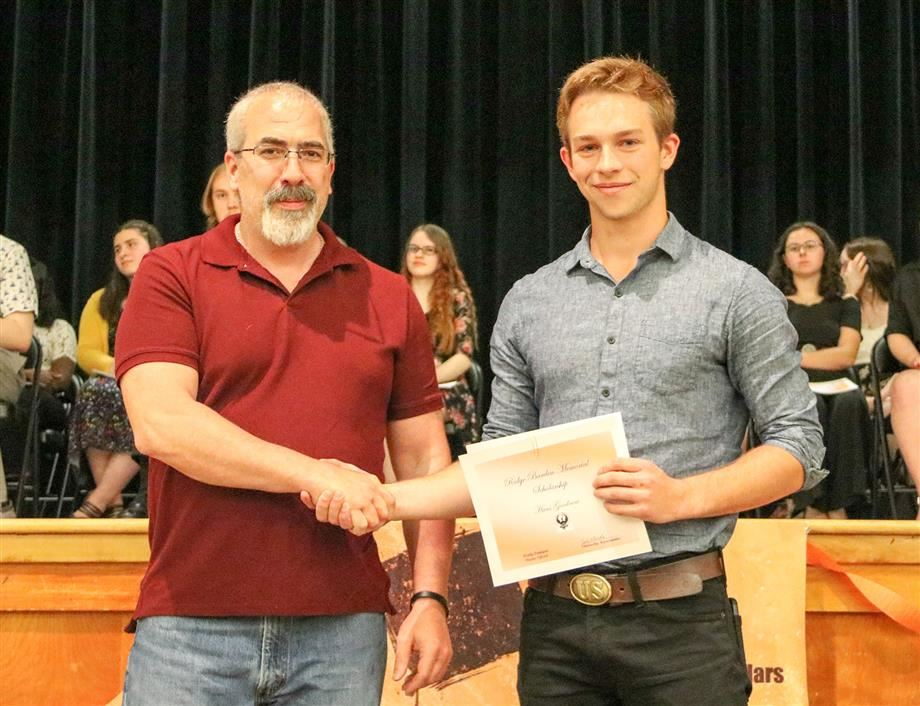 Jody Barden presents the Ridge Barden Memorial Scholarship to JCB senior Hans Goodnow.