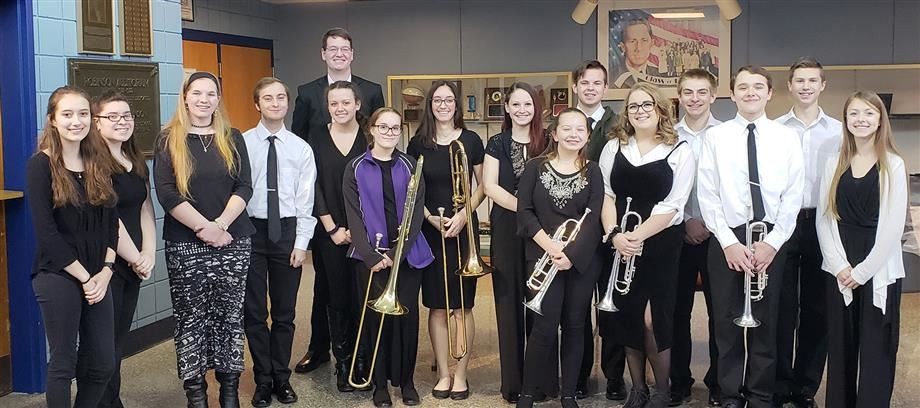 JCB student musicians stand outside the Oswego High School auditorium.