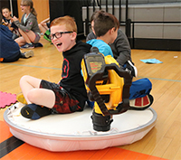 Cole Bailer is all smiles as he tests out the hovercraft his team built.