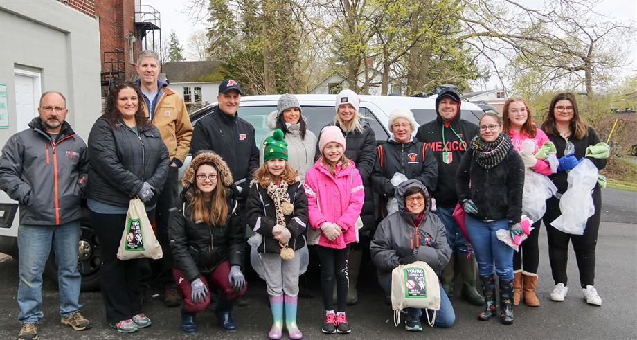 Members of the Phoenix school community join local residents for a recent cleanup effort.