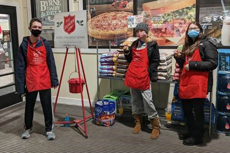 Dominic Germain, Alaina Hubbell and Kenidee Grover volunteer as Salvation Army bell ringers