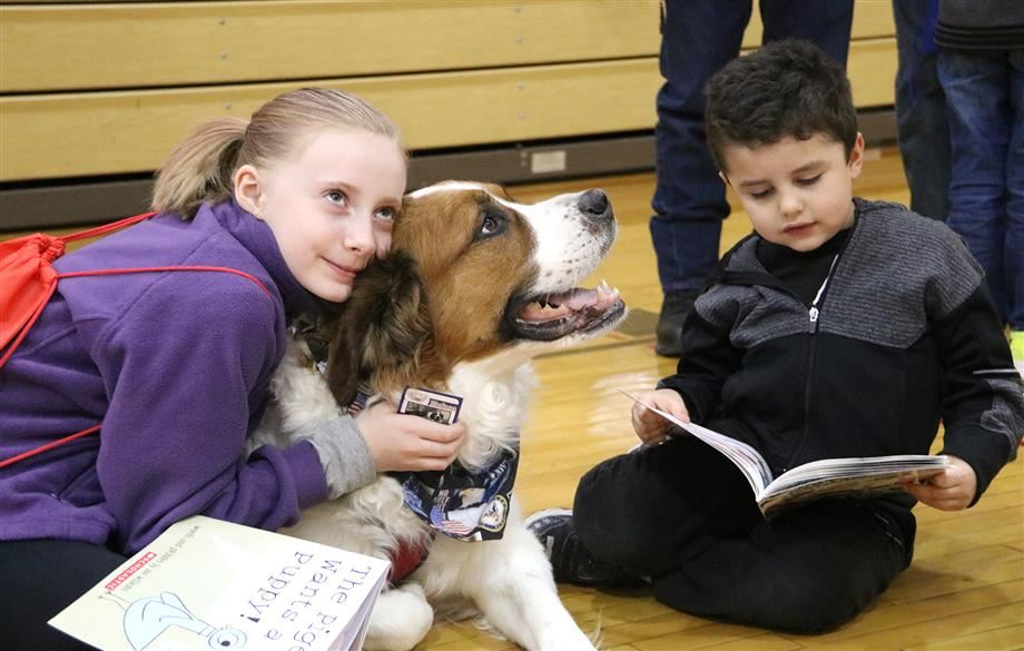 Michael A. Maroun Elementary students read with a therapy dog during a recent family literacy night