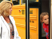 Students participate in a bus safety drill