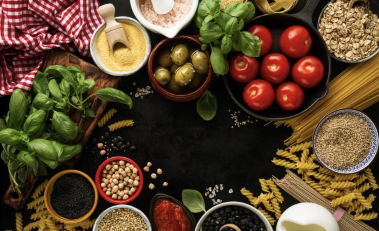 photo of different fruits, vegetables and spices on black background